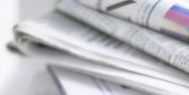 Ein Stapel mit Zeitungen